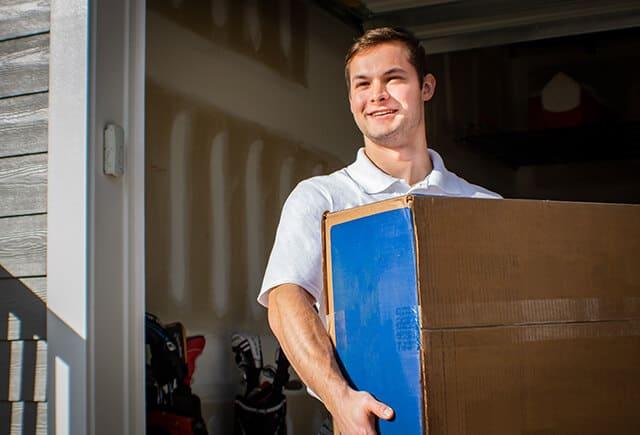 Junk Pros NY employee holding box