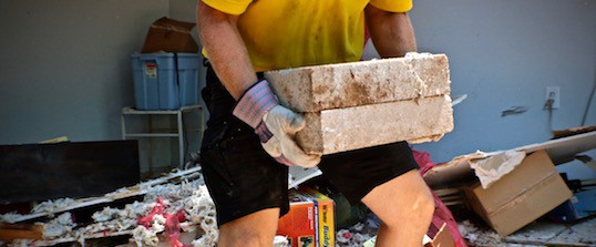 concrete block removal by a strong junk pros team member