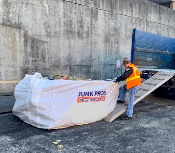 Hauling a Junk Pros NY dumpster bag