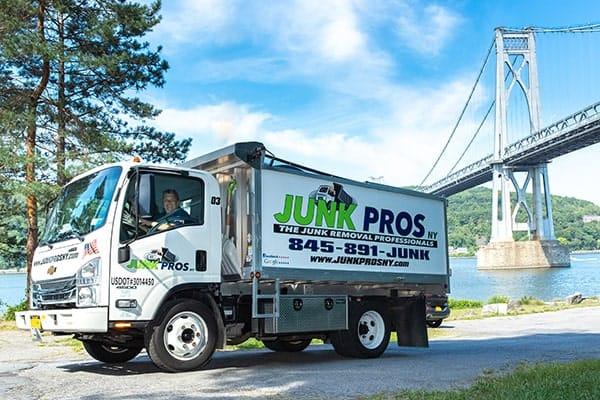 Junk Pros NY truck in front of bridge